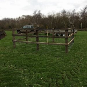small wooden fence in a field