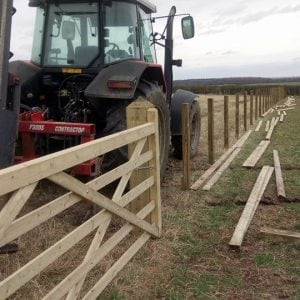 fence in field getting built