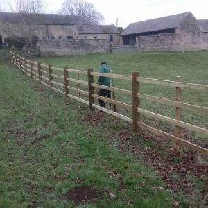 wooden fence in field